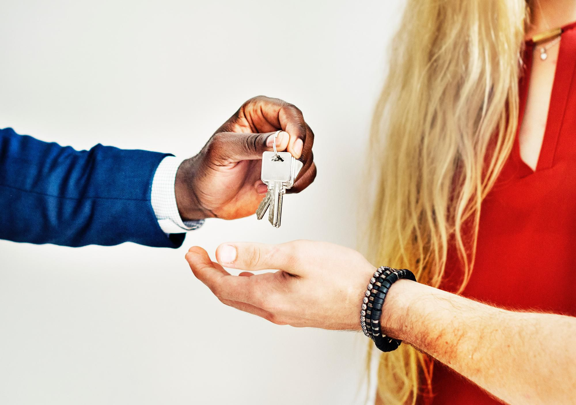 Handing Keys to New Tenant for property management