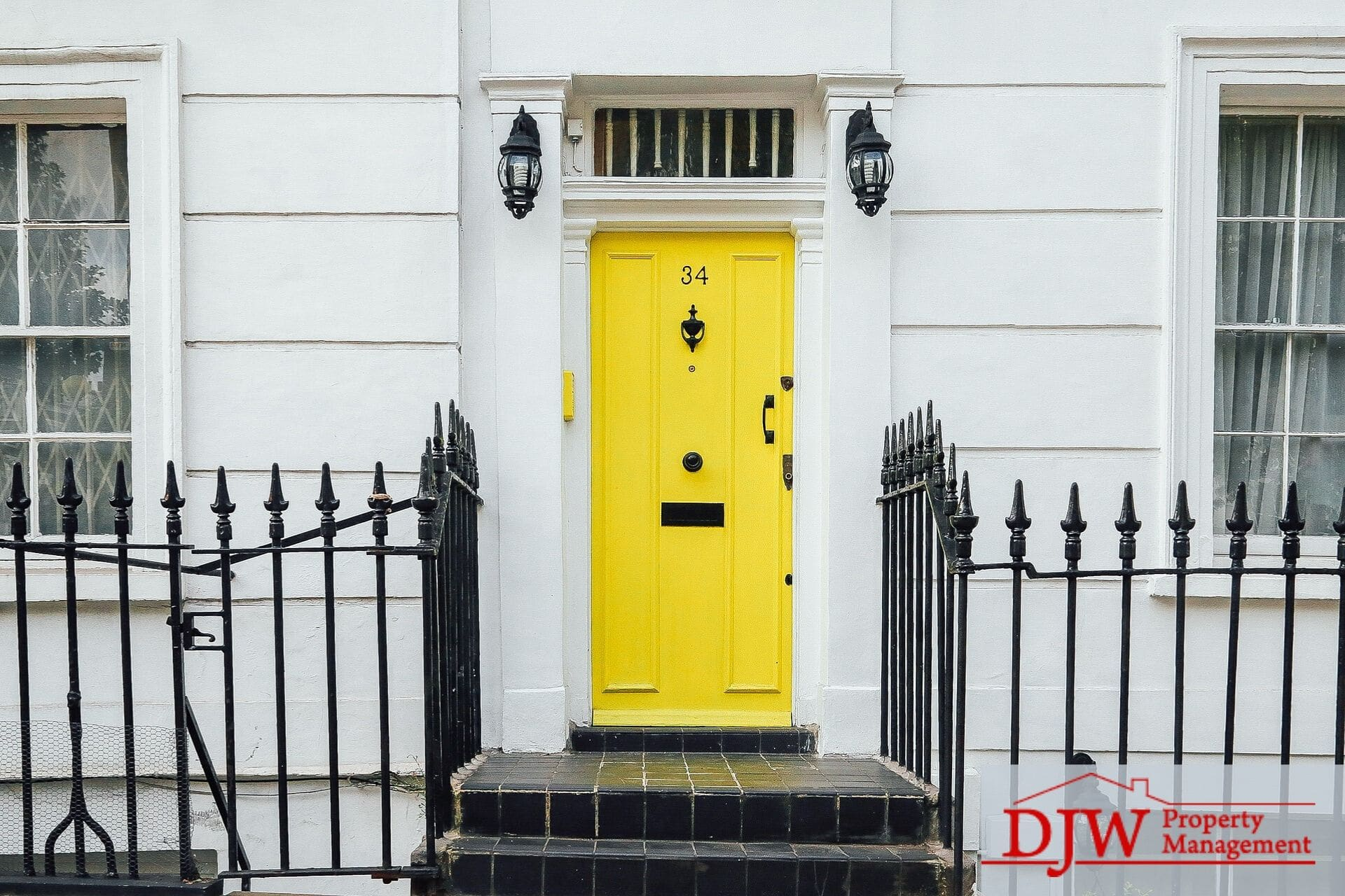 An entrance to an apartment with a yellow door