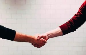 A tenant shaking hands with his new landlord