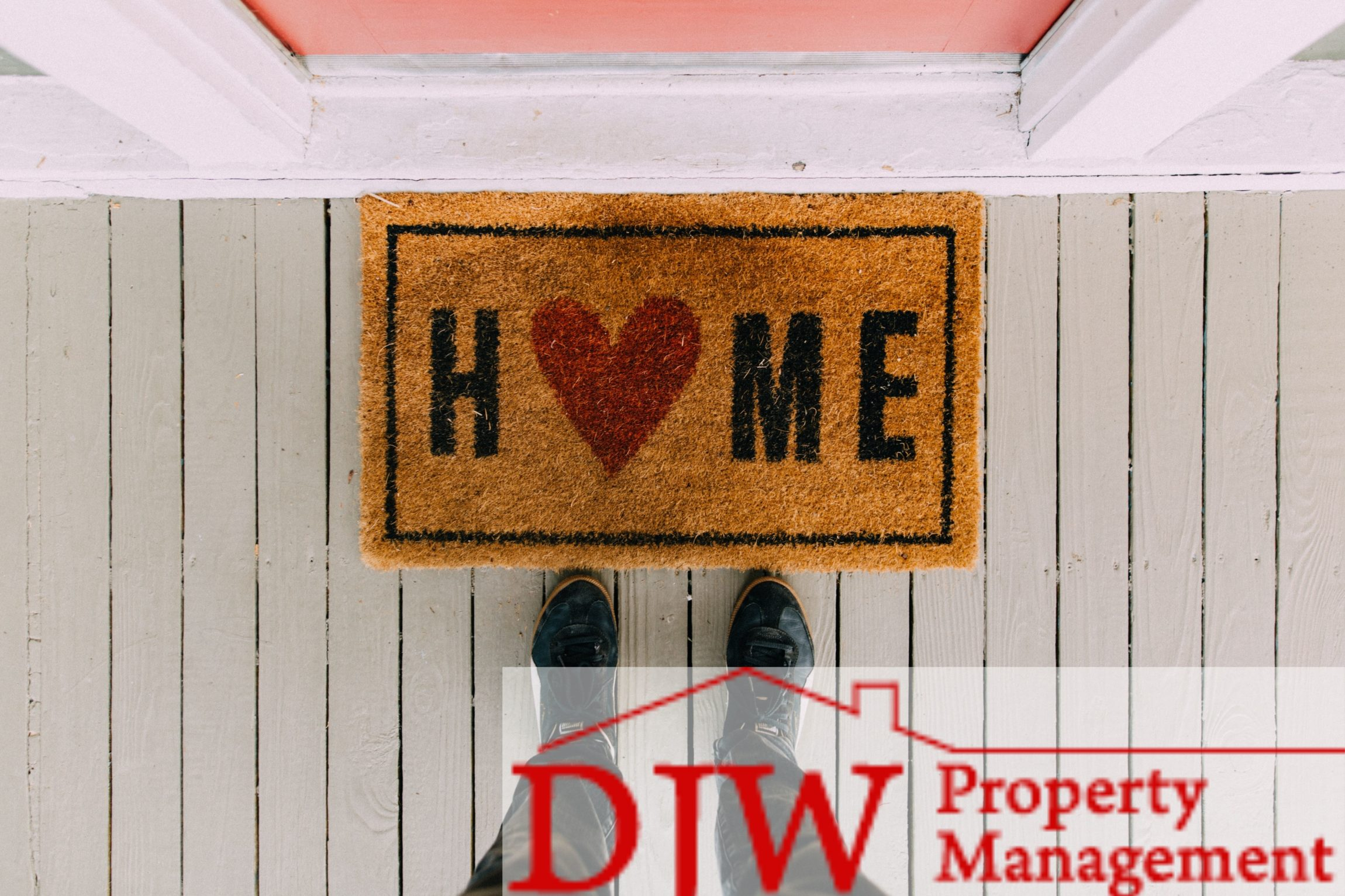 Doormat that says 'home' with a red heart